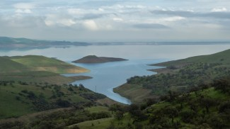 San Luis Reservoir, just west of the San Joaquin Valley town of Los Banos, is California's sixth-largest reservoir and stores water pumped south from the Delta by the federal Central Valley Project and State Water Project. February 2015.