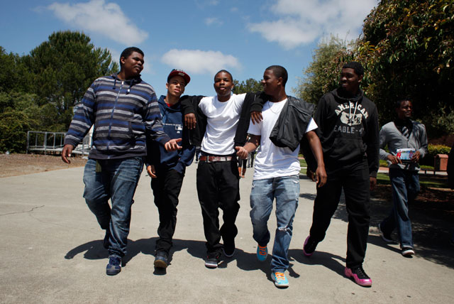 Melvin Thomas, left, Marcell Stargetti, Anthony Dennis, Roashon Wilson, and James McCullough walk arm and arm through the campus of California State University  East Bay, Friday May 17,  2013,  in Hayward, Calif. (Lacy Atkins/The Chronicle)