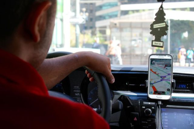 Adnan Aloudi, a full-time Uber and Lyft driver, drives through downtown San Francisco.
