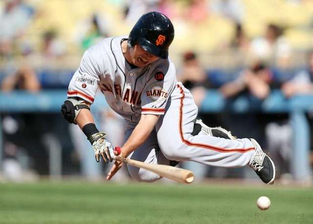 LOS ANGELES, CA - JUNE 20: Nori Aoki #23 of the San Francisco Giants goes down after being hit by a pitch in the anke in the first inning against the Los Angeles Dodgers at Dodger Stadium on June 20, 2015 in Los Angeles, California.  (Photo by Stephen Dunn/Getty Images) Photo: Stephen Dunn, Getty Images