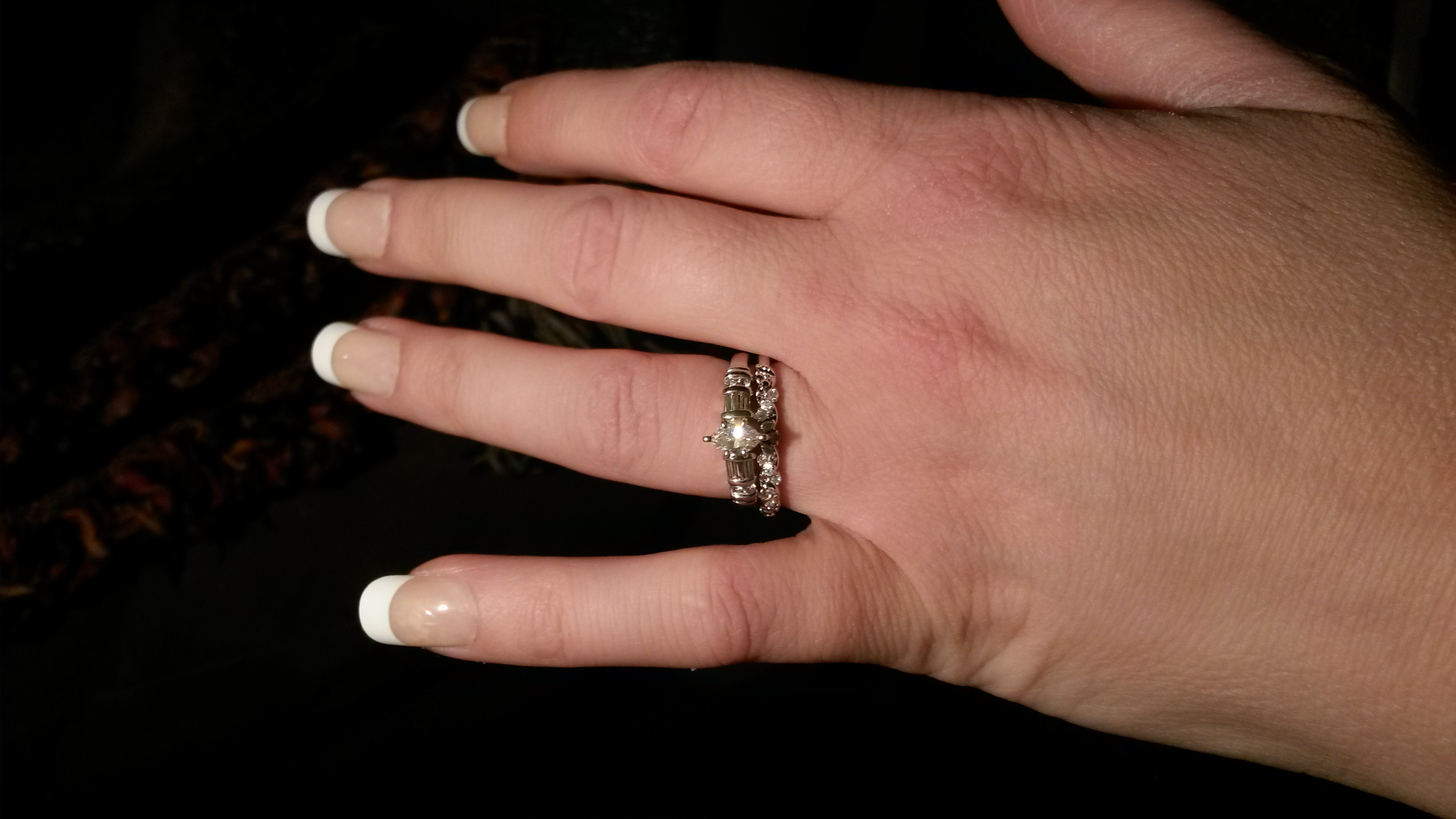 4 wedding rings under It s a half carat marquise with tapered baguettes and round side stones on a platinum band I felt like I stole it for under