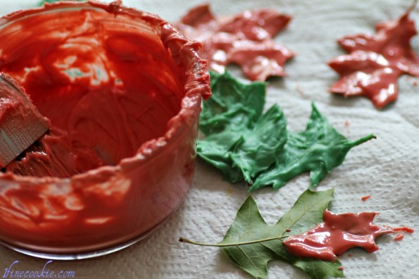 paint chocolate onto the bottom of the leaves