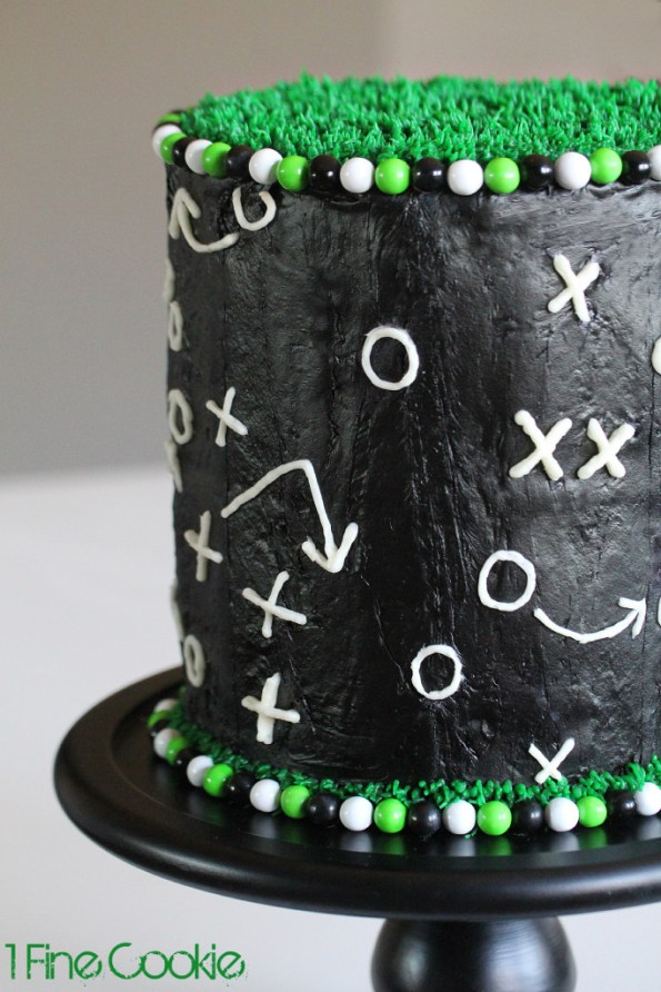 Football Field cake by 1 Fine Cookie, football, cake, frosting, gameplay, game, cake, field, grass, green, black, white, cake, candy, frosting, covered, decorated, easy, superbowl, 2014, 2015, cupcake, beginners, piping, x, o, x's, o's, sixlets, gumballs,