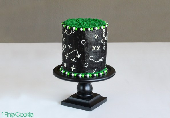 Game Play Football Cake by 1 Fine Cookie, football, cake, frosting, gameplay, game, cake, field, grass, green, black, white, cake, candy, frosting, covered, decorated, easy, superbowl, 2014, 2015, cupcake, beginners, piping, x, o, x's, o's, sixlets, gumballs,