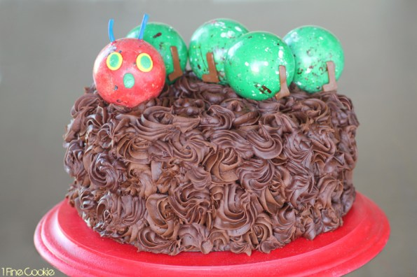 Very Hungry Caterpillar Cake by 1 Fine Cookie, Hungry, Caterpillar, cake, topper, cupcake, piping, frosting, swirl, corkscrew, gum ball, decoration, how, to, idea, children, child's, kids, birthday, party, sprinkles, tootsie rolls, fondant, candy, green, red, book, literature, kindergarten, reading, theme, school, class, teachers, legs, antlers, easy,