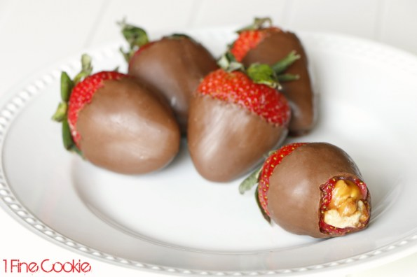Snickers Stuffed Strawberries Recipe by 1 Fine Cookie, Snickers, super bowl , dessert, filled, stuffed, candy, strawberries, football, field, giveaway, contest, sweepstakes, strawberry, chocolate, dipped, valentine's, day, gift, diy, how to, candy, melts, decorating, white, green, piping, recipe, fruit, caramel, peanuts, nfl, patriots, seahawks, tailgate, tailgating, cute, party, food, free, superbowl, nougat, ideas, leftover,