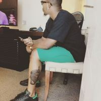 Olamide Flaunts Oduduwa Inspired Leg Tattoo (Photos)