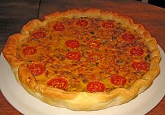 Pasta sfoglia con ricotta e pesto: un deliziosa torta rustica
