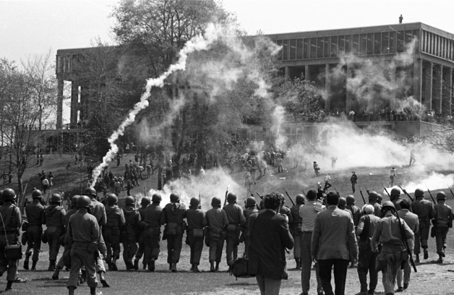 Troops fire tear gas at protesters. Kent State University photo