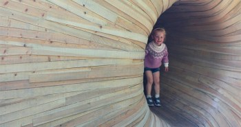 But the most distinctive part is the fantastic, pine shaving entrance tunnel that welcomes adults and kids alike to Bergen's first and only off-grid hotel room.