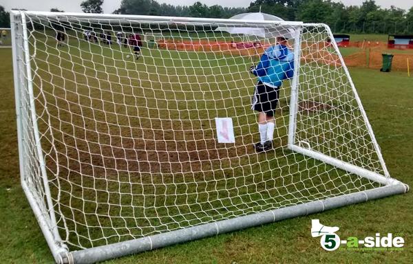 Lazy Goalkeeper holding Umbrella