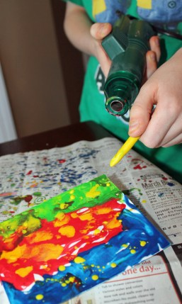 The dryer will melt the crayons and spray the wax artistically.