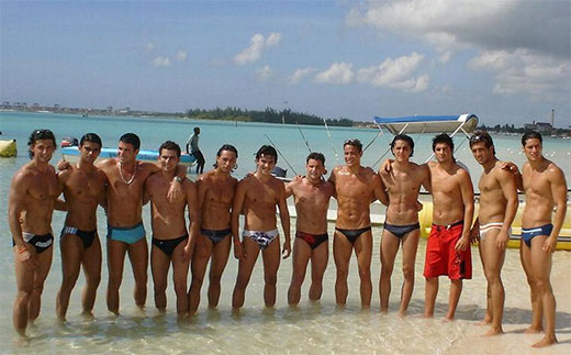 Odd guy out in board shorts