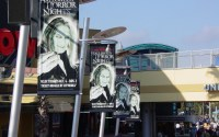 """Banners featuring """"The Caretaker"""" decorate Citywalk during Halloween Horror Nights 12.  Photo by HauntFreaks."""