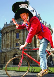 Mad hatter on bike by radcliffe camera image