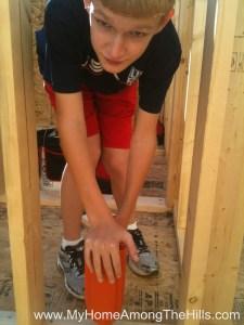 Isaac using the pasolode propane framing nailer