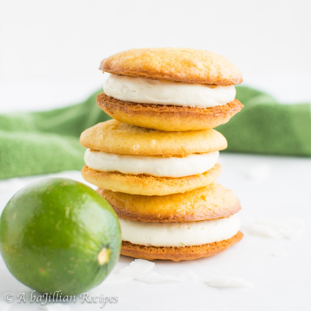 Tart and tangy lime cheesecake filling sandwiched between two light and fluffy coconut cake cookies!