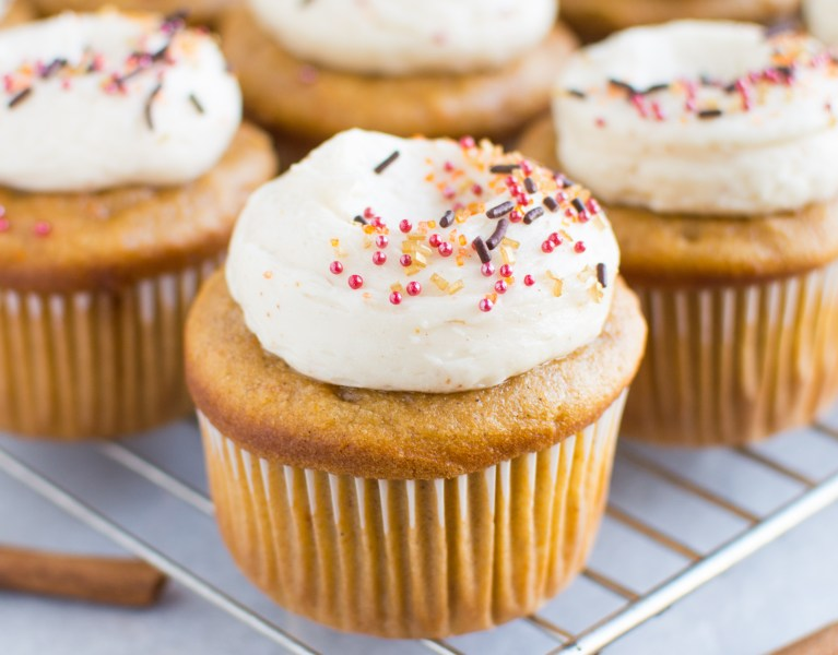 The BEST sweet potato cupcakes topped with a cloud of fluffy brown butter maple buttercream!