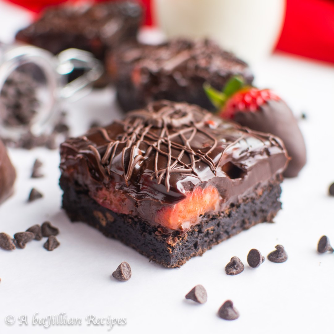 Ultra dense and fudgy brownies topped with fresh strawberries and smothered in rich dark chocolatey ganache!