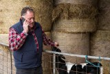 Dairy farmer Michael Perkins fields dozens of calls a day from people wanting to donate around Tasmania
