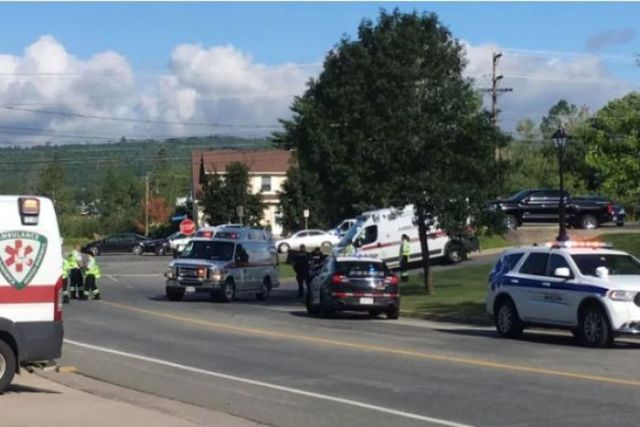Emergency and police vehicles are seen at the shooting scene.