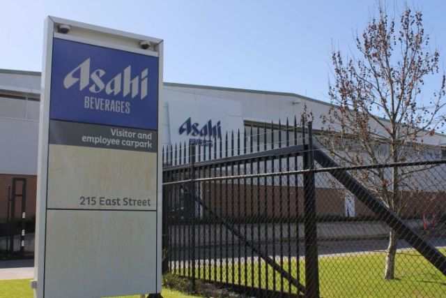 The Albury Asahi factory sign with barbed wire behind it