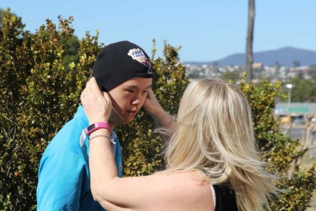 Ms Threlfo helps Jordy put a beanie on as he heads off to work.