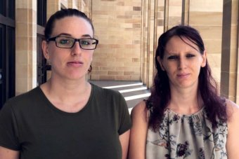 Skye Quartermaine and her sister Dee on the steps of Parliament House