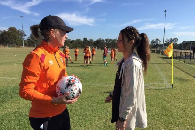 After breaking her back playing in the US, Hayley Raso makes an emotional return to watch Brisbane Roar pre-season training.