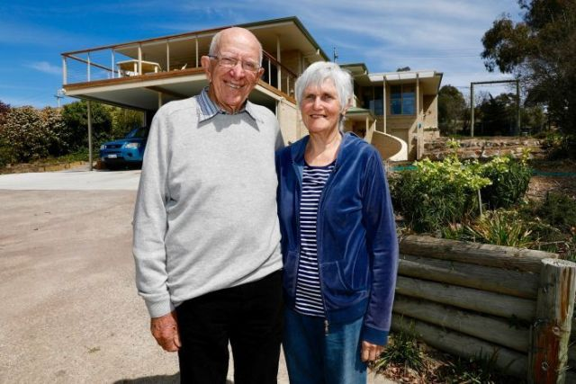 John and Trish Hagan pose outside their house.