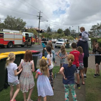 Morningside State School kids gather to watch the fireys work