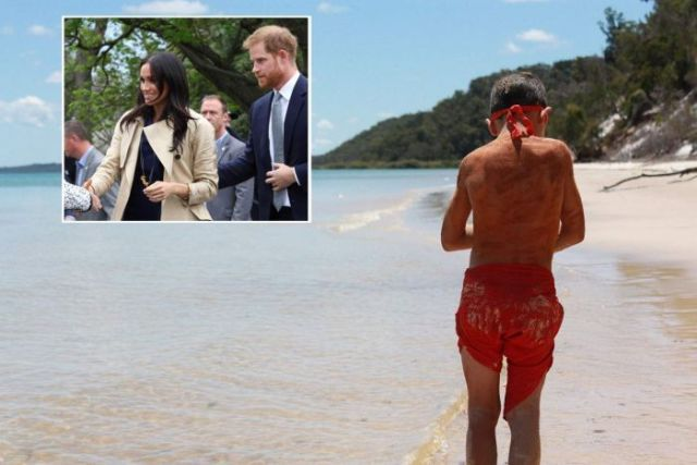 Boy stand on beach facing away from camera with image of Prince Harry and Meghan Markle embeded in corner.