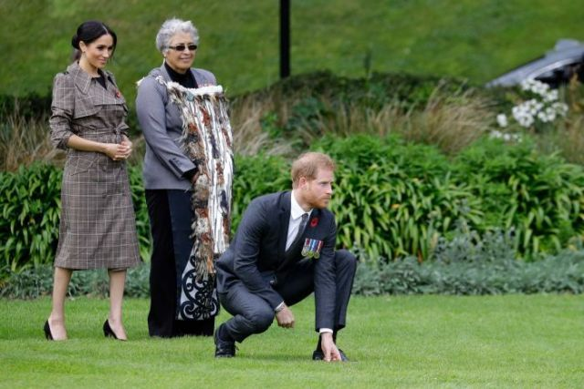 Prince Harry kneels in traditional Maori welcome ceremony