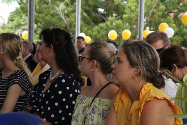 Hundreds wore yellow to signify the school house that Olivia captained.
