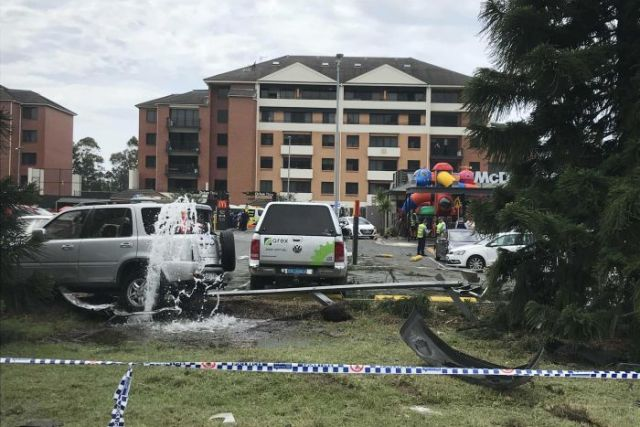 Damaged cars and a burst water main