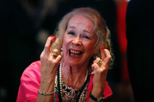 A supporter of Republican Senate candidate crosses her fingers at an election watch party.