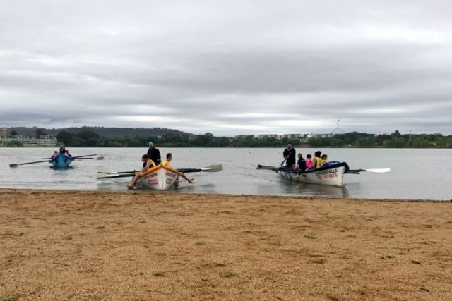 Three surf boat crews out on Lake Burley Griffin on a rainy Canberra day.
