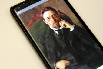 Painting of Russian playwright Anton Chekhov on a phone screen.
