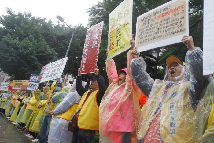 Taiwan protesters demand tax reform outside of Ministry of Finance in Taipei, Taiwan.