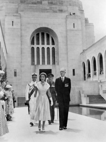 The Queen walks with Charles Bean through the Hall of Memory at the Australian War Memorial in Canberra.