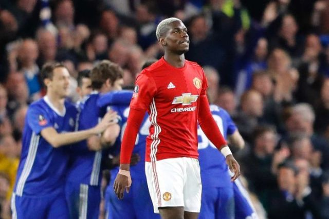 Paul Pogba grimmaces after loss to Chelsea