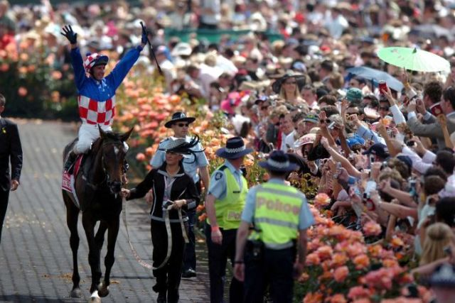 Jockey Glen Boss atop Makybe Diva celebrates after the 2005 Melbourne Cup on November 1, 2005.