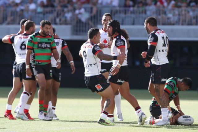 Isaiah Papali'i (R) of the Warriors is congratulated after his try against South Sydney in Perth.