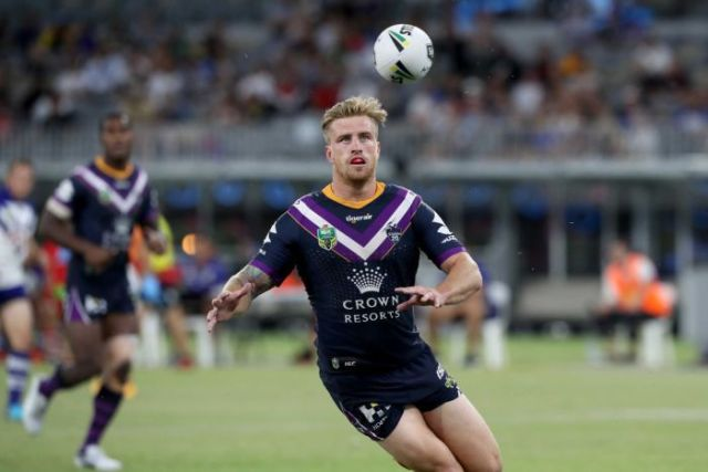 Cameron Munster of the Storm prepares to catch the ball against the Bulldogs in Perth.