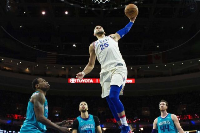 Philadelphia 76ers' Ben Simmons goes up for a dunk against Charlotte Hornets.