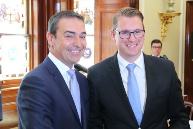 Steven Marshall shaking hands on the day his new Government is sworn in, March 22, 2018.