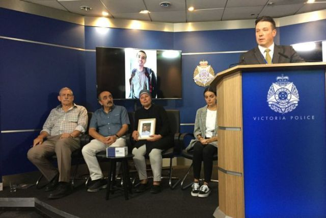 The Yucel family sit behind a podium during a police press conference.