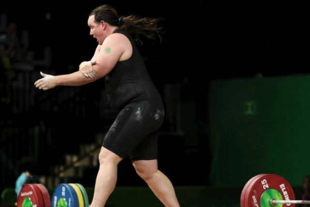New Zealand's Laurel Hubbard clutches her arm.