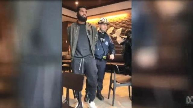 Two black men are arrested in a US Starbucks cafe