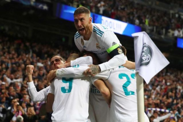 Karim Benzema celebrates a goal with his Real Madrid teammates against Bayern Munich.